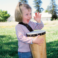 Girl playing conga drum