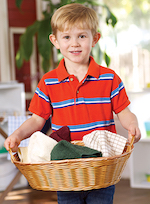 Boy with laundry basket