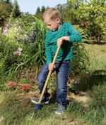 Boy Digging in Garden
