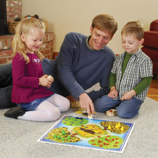 Man and children playing a game