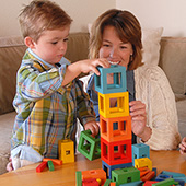 Mom building blocks with son